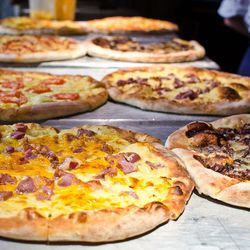 Options include things like prosciutto and cheddar or duck heart tamarind pizza.
