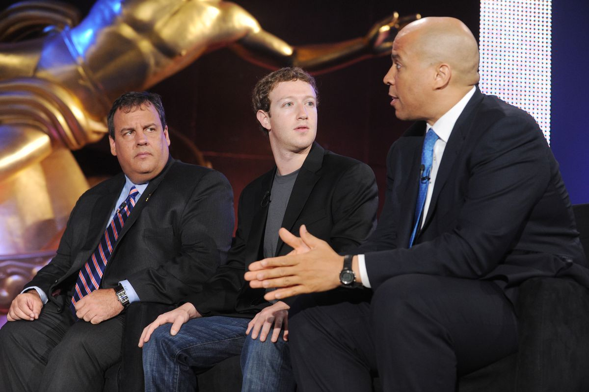 Mark Zuckerberg onstage with Chris Christie and Cory Booker.