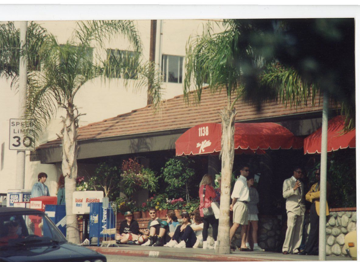 A vintage photo of customers waiting in line for a 24 hour restaurant.