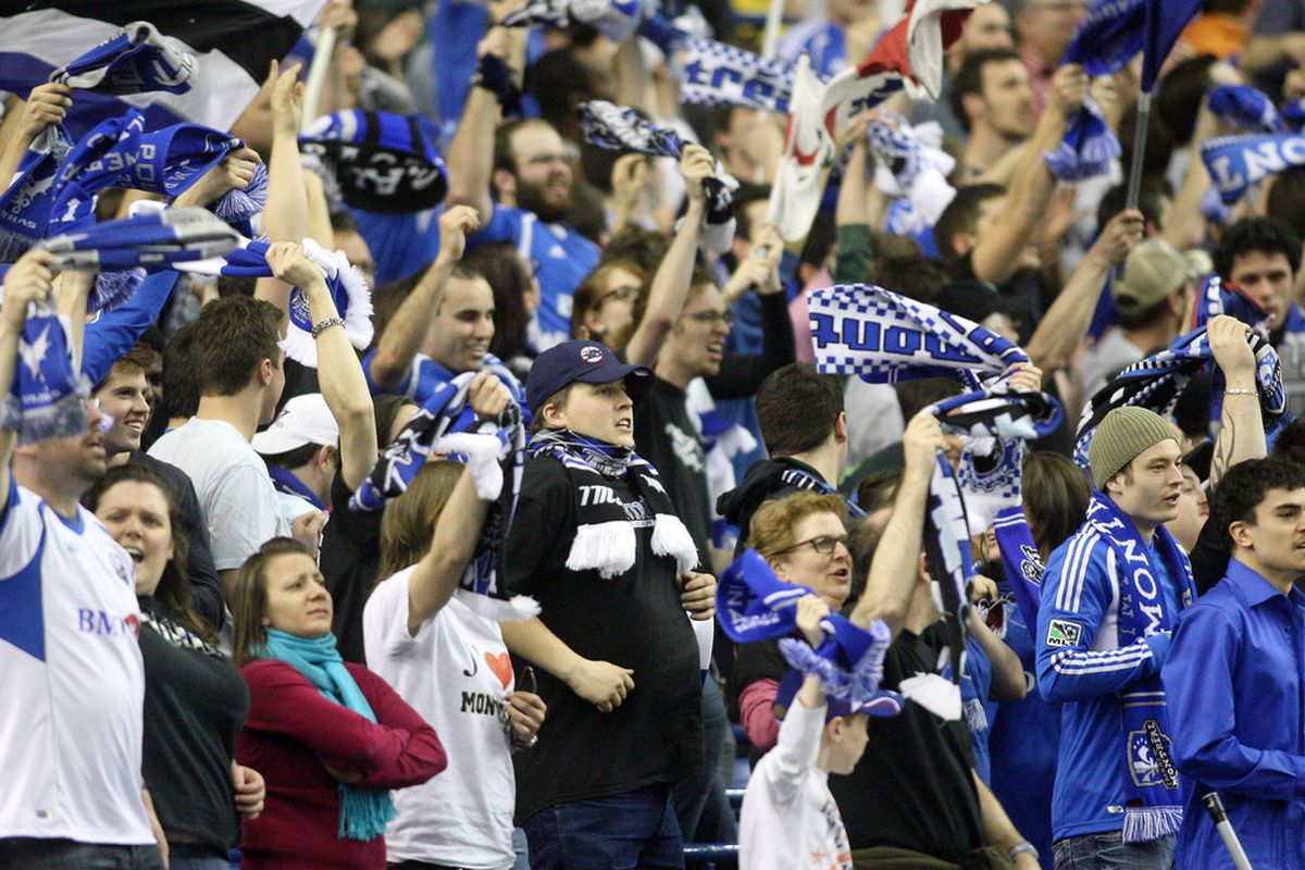 MONTREAL, CANADA - MAY 2:  Fans cheer for the Montreal Impact during the Amway Canadian Championship Series match against the Toronto FC at the Olympic Stadium on May 2, 2012 in Montreal, Quebec, Canada.  (Photo by Richard Wolowicz/Getty Images)