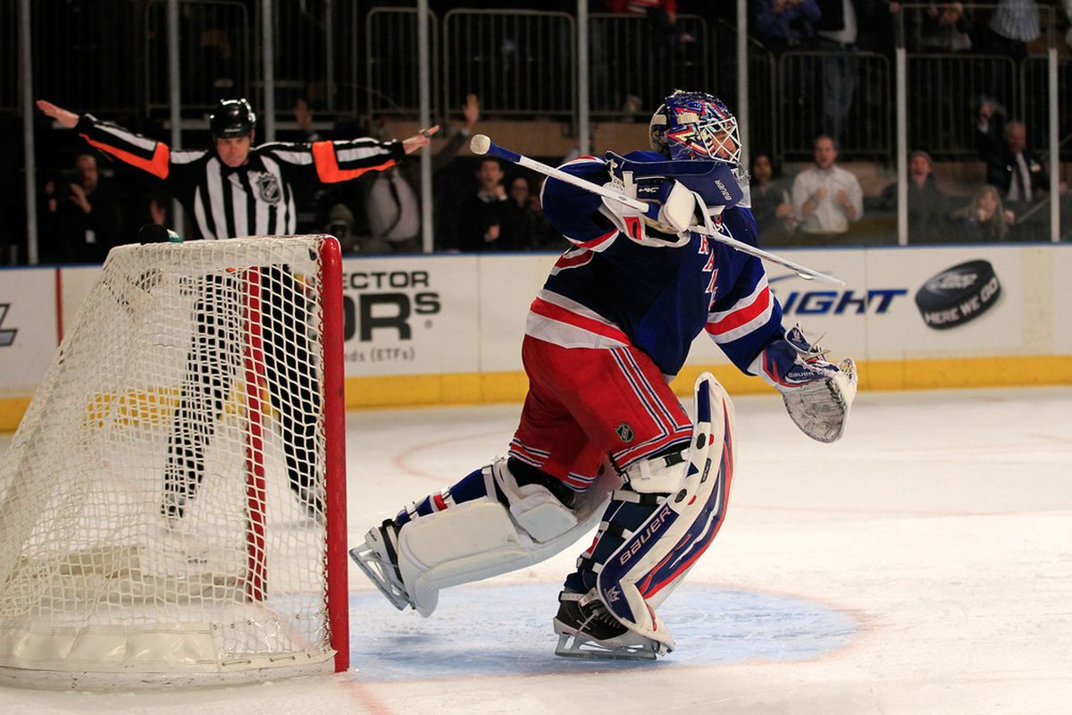 Henrik Lundqvist #30 of the New York Rangers reacts after game winning block of S(ane Doan #19 of the Phoenix Coyotes in a penalty shoot out at Madison Square Garden on January 10, 2012 in New York City.  (Photo by Chris Trotman/Getty Images)