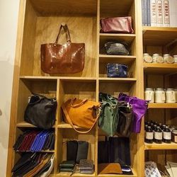 A back shelf holds bags and fun odds and ends including a coffee-table book on India and jams from Shady Acres Farm.