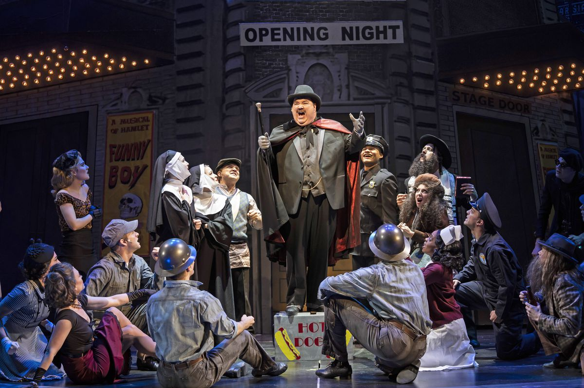 """Blake Hammond (center) stars as Broadway producer Max Bialystock in this scene with the ensemble of """"The Producers"""" at the Paramount Theatre, 23 E. Galena Blvd., Aurora. 