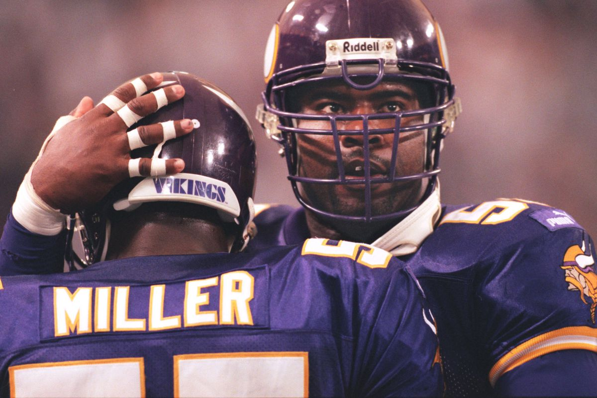 Minneapolis, MN 10/3/99 Vikings vs. Tampa Bay Buccaneers — Viking defensive end Chris Doleman, right, congratulates teammate Corey Miller after Miller intercepted a Tampa Bay touchdown in the fourth quarter Sunday at the Metrodome. The play was an import