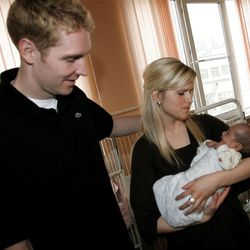 Travis Hansen, left, and his wife LaRee spend time with Russian babies at an orphanage in 2007.