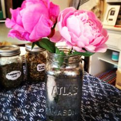 Bonus DIY: ball jars turned into mercury jars with a little water, vinegar, and looking glass spray paint — perfect to use as a vase or as a storage container for the tea bags