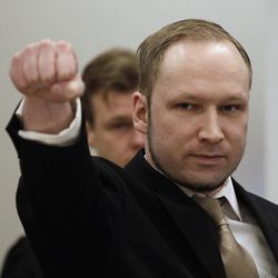 Norwegian Anders Behring Breivik gestures as he arrives at a courtroom, to face terrorism and premeditated murder charges, Oslo, Norway, Monday, April 16, 2012. Breivik, who confessed to killing 77 people in a bomb-and-shooting massacre went on trial in Norway's capital Monday, defiantly rejecting the authority of the court.