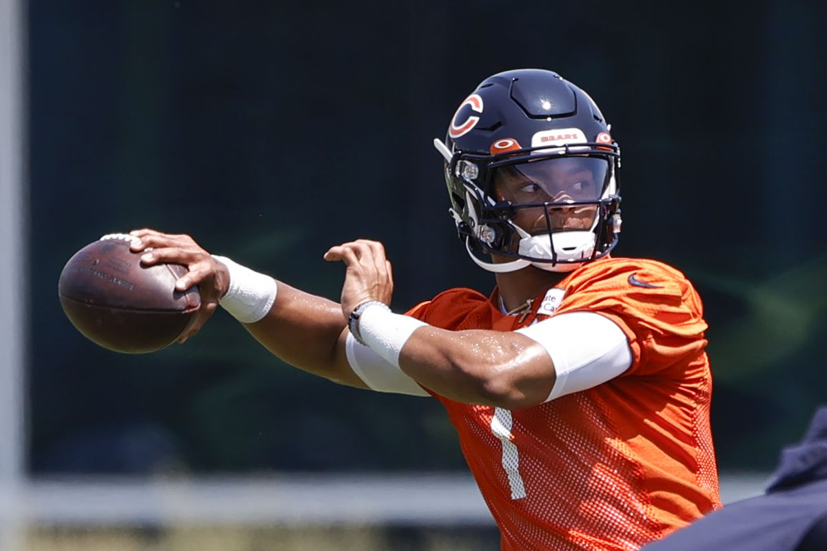 Chicago Bears quarterback Justin Fields (1) passes the ball during organized team activities at Halas Hall.
