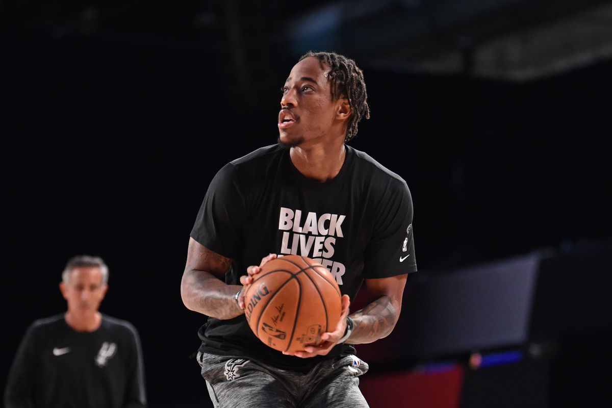 DeMar DeRozan of the San Antonio Spurs warms up before the game against the Denver Nuggets on August 5, 2020 in Orlando, Florida at Visa Athletic Center at ESPN Wide World of Sports.