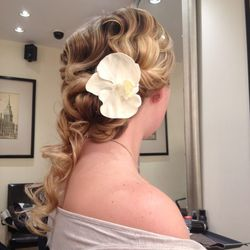 """<b>Franc Magri, stylist at <a href=""""http://www.giovannipileggi.com/"""">Giovanni & Pileggi</a> in Midtown Village:</b> """"This first look, the faux finger wave, is a modern take on the classic twenties style. The perfectly placed loose curls create the illusio"""