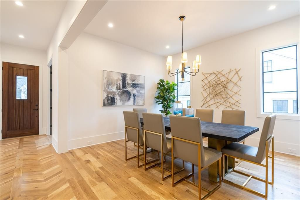 A dining room with wood floors.