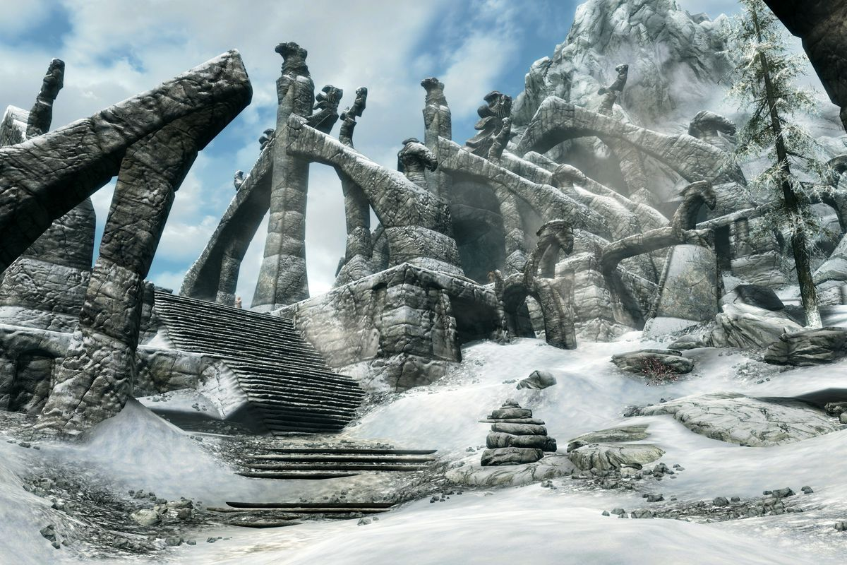 A dark granite structure emerging from the snow on a distant mountain peak in The Elder Scrolls 5: Skyrim