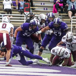 The Weber State Wildcats' quarterback Bronson Barron (10) scores the last touchdown for the Wildcats in the fourth quarter at Stewart Stadium in Ogden on Saturday, April 24, 2021.