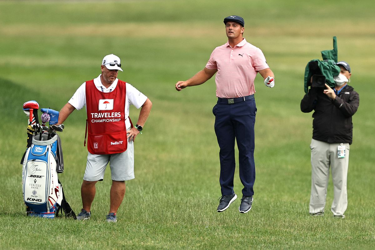 Bryson DeChambeau of the United States jumps after playing his shot on the 18th hole during the final round of the Travelers Championship at TPC River Highlands on June 28, 2020 in Cromwell, Connecticut.