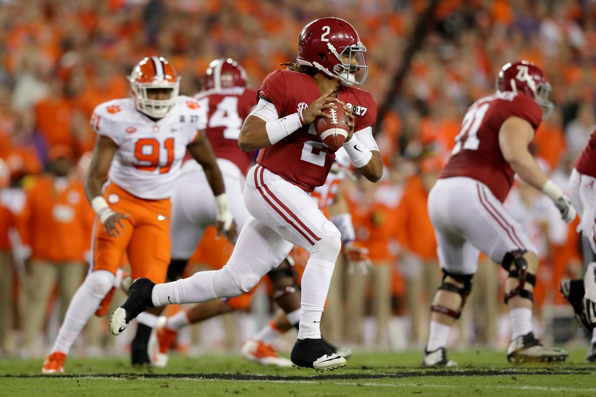Jalen Hurts looks to pass against the Clemson Tigers in the 2017 College Football Playoff championship game