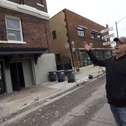 Fred Moesinger, owner of BTG Wine Bar and Caffe Molise in Salt Lake City, looks at damage to his building after a 5.7 magnitude earthquake centered in Magna hit early on Wednesday, March 18, 2020.