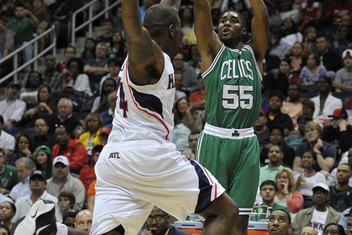 Apr 20, 2012; Atlanta, GA, USA; Boston Celtics guard E'Twaun Moore (55) pulls up for a shot over Atlanta Hawks forward Ivan Johnson (44) during the second half at Philips Arena. The Hawks won 97-92. Mandatory Credit: Paul Abell-US PRESSWIRE