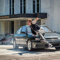"""Baby (Ansel Elgort) is chased by the cops in """"Baby Driver."""""""