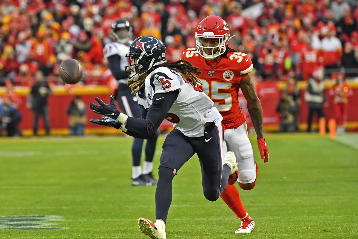 Wide receiver Will Fuller of the Houston Texans catches a pass down field against cornerback Charvarius Ward of the Kansas City Chiefs in the second half during the AFC Divisional playoff game at Arrowhead Stadium on January 12, 2020 in Kansas City, Missouri.