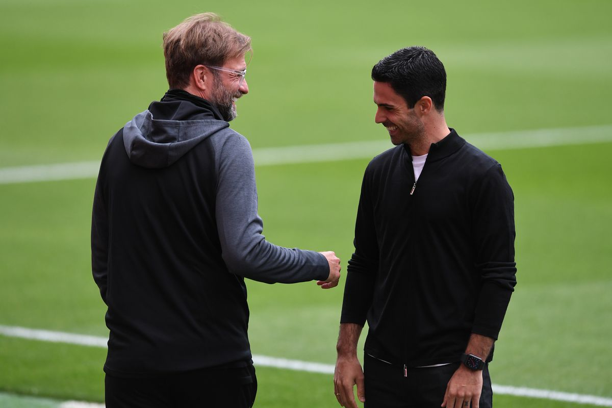 Mikel Arteta the Arsenal Head Coach says hello to Jurgen Klopp the Liverpool Manager before the Premier League match between Arsenal FC and Liverpool FC at Emirates Stadium on July 15, 2020