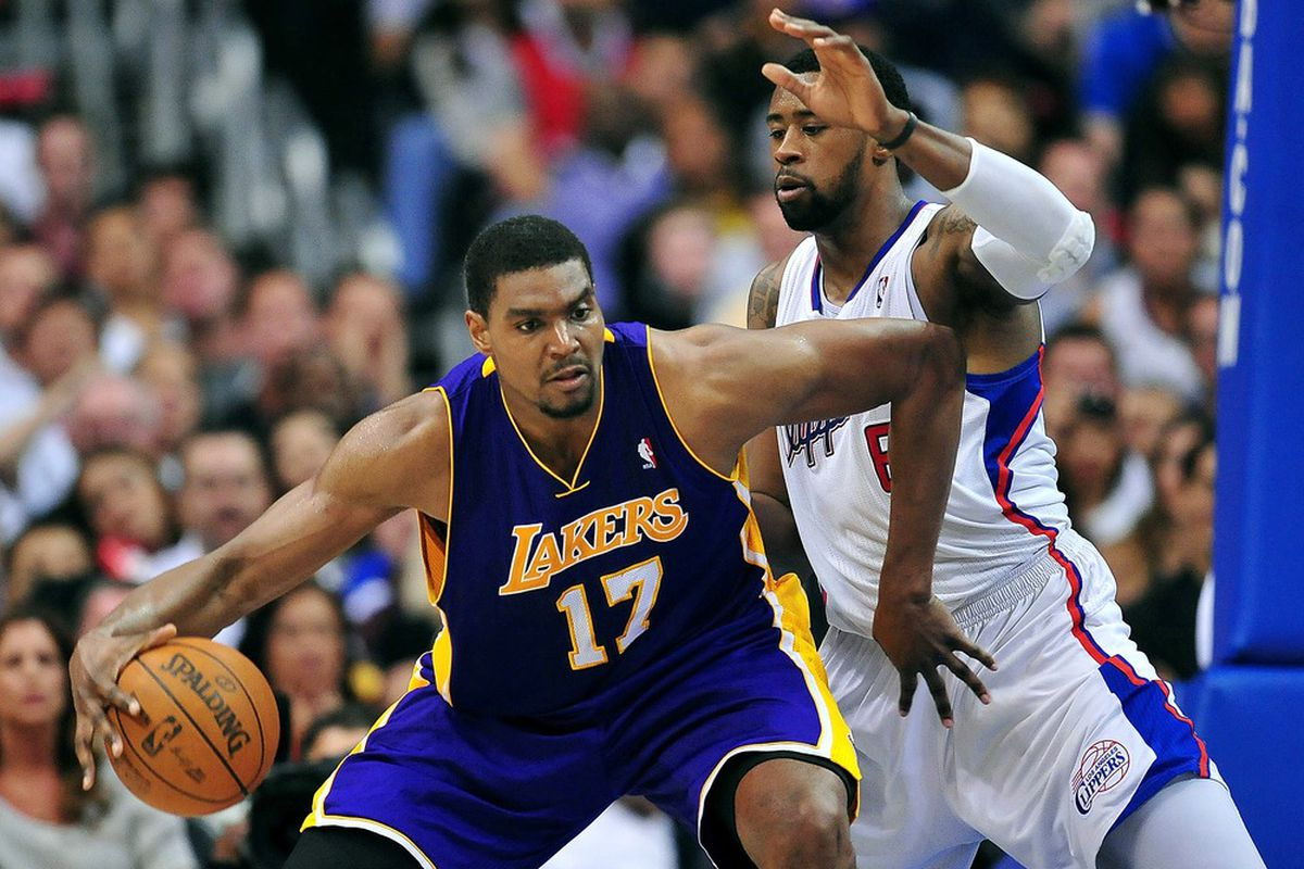 April 4, 2012; Los Angeles, CA, USA; Los Angeles Lakers center Andrew Bynum (17) controls the ball against the Los Angeles Clippers during the second half at Staples Center. Mandatory Credit: Gary A. Vasquez-US PRESSWIRE