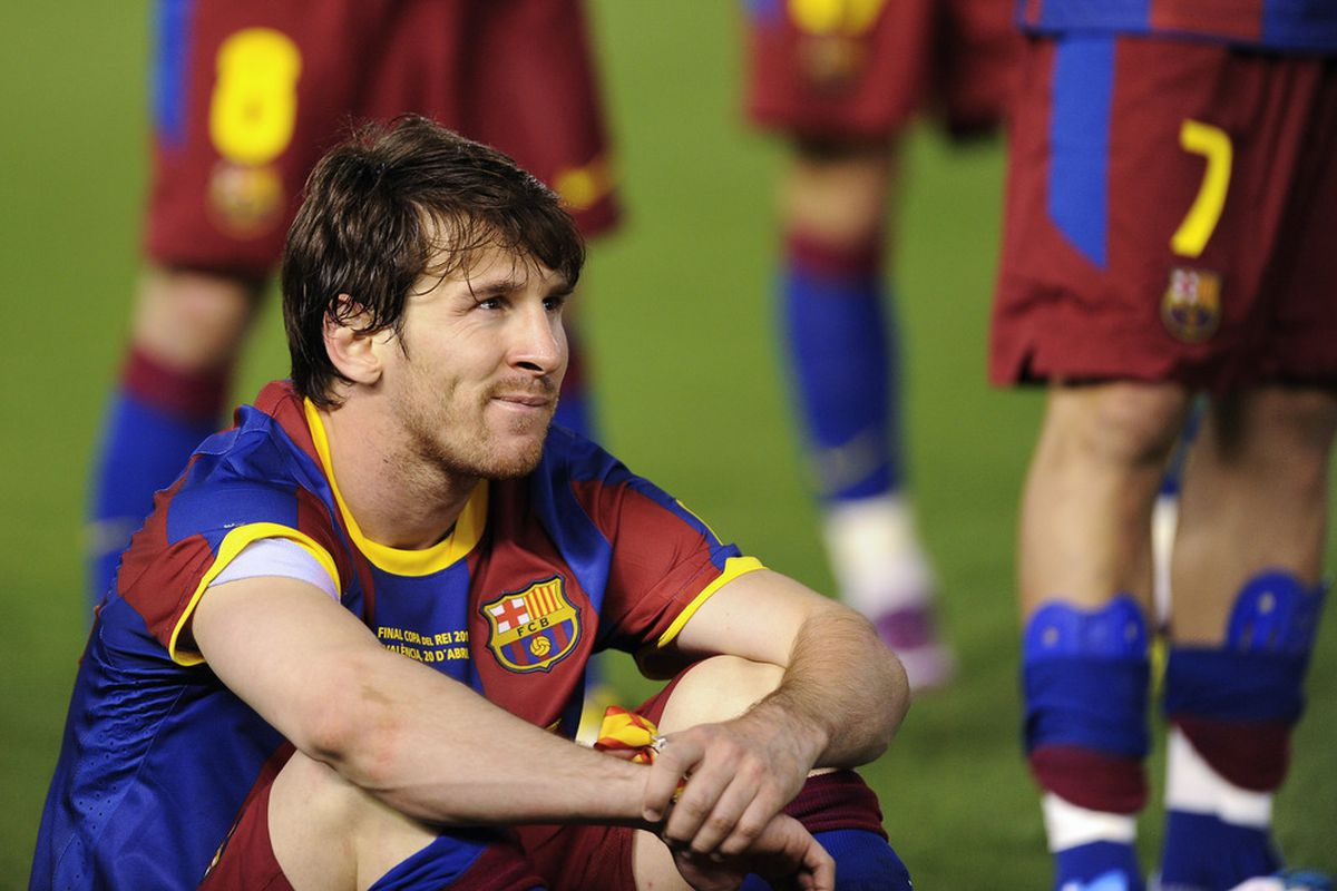 Lionel Messi of FC Barcelona looks on dejected after being defeated by Real Madrid in the Copa del Rey Final.
