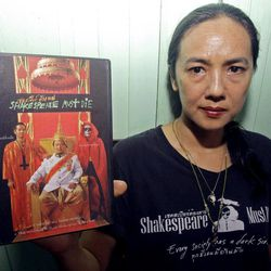 """Director of """"Shakespeare Must Die"""" Ing Kanjanavanit shows a DVD sent to Thai film censorship board in Bangkok, Thailand, during an interview on Wednesday, April 4, 2012. The censors banned an adaptation of Shakespeare's """"Macbeth,"""" saying it could inflame political passions in the country where it is taboo to criticize the monarchy. The Thai-language film """"Shakespeare Must Die"""" is about a theater group in a fictional country resembling Thailand that is staging a production of """"Macbeth,"""" in which an ambitious general murders his way to the Scottish throne."""