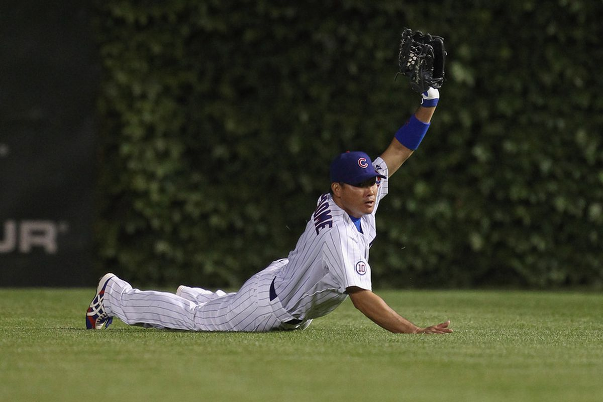 Kosuke Fukudome of the Chicago Cubs holds up the ball after making a diving catch against the San Francisco Giants at Wrigley Field on June 29, 2011 in Chicago, Illinois. The Cubs defeated the Giants 2-1. (Photo by Jonathan Daniel/Getty Im ages)