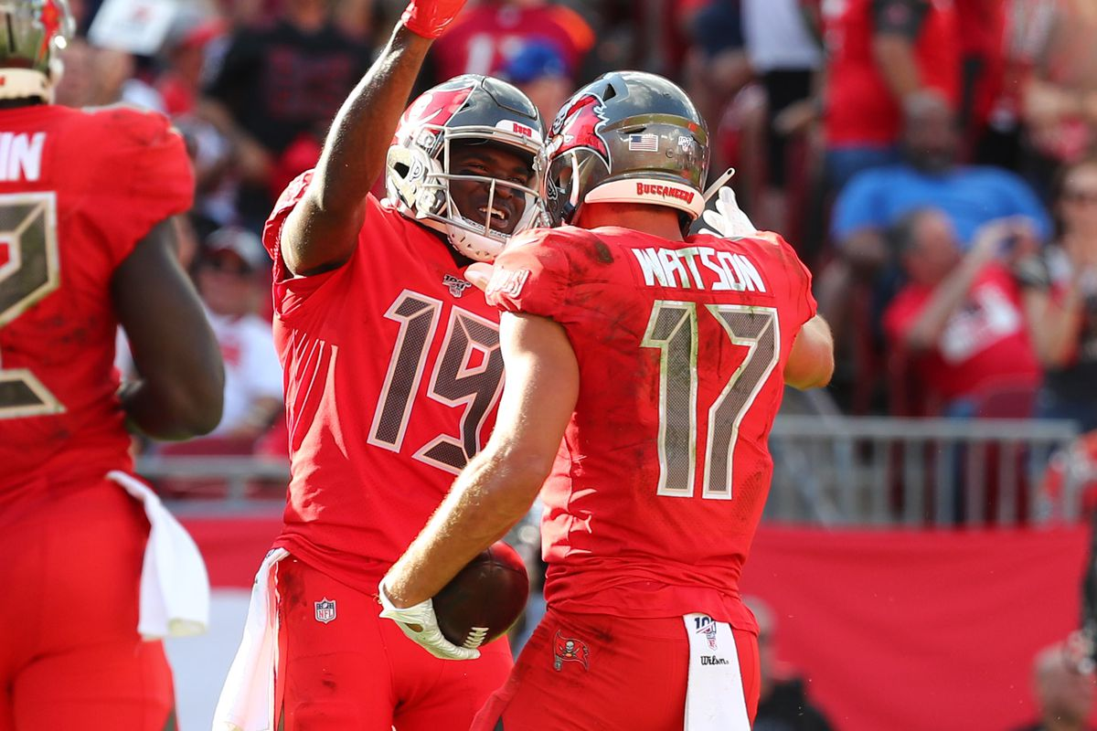 Tampa Bay Buccaneers wide receiver Justin Watson is congratulated by wide receiver Breshad Perriman as he scores a touchdown against the Indianapolis Colts during the second half at Raymond James Stadium.