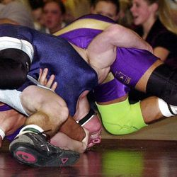Zach Lamano(face to right, feet to left) defeats Bryant Anderson in the 135 pound classification in the high school wrestling all-star classic at Jordan High School January 8, 2001. photo by ravell call