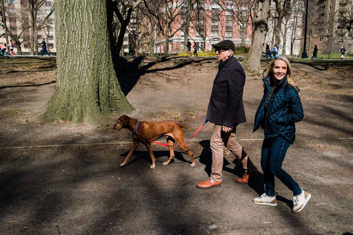 """Dana Perino, her husband, Peter McMahon, and their dog Jasper go for a walk in Central Park in New York on Sunday, March 21, 2021. Perino just released her book, """"Everything Will Be Okay: Life Lessons for Young Women"""" earlier in March."""