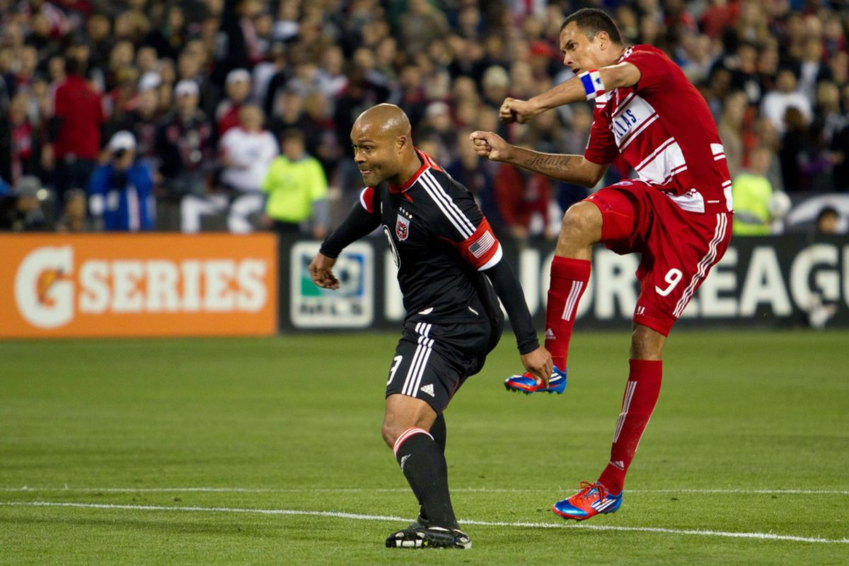Mar 30, 2012; Washington, DC, USA; FC Dallas forward Blas Perez (9) takes a shot while DC United defender Robbie Russell (3) watches during the second half at RFK Stadium.  Mandatory Credit: Paul Frederiksen-US PRESSWIRE