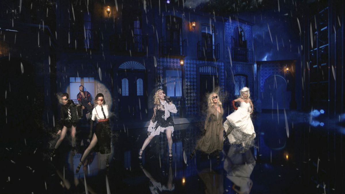 """Madonna, with Maluma (background) is accompanied by augmented reality technology """"pals"""" during her performance Wednesday night at the Billboard Music Awards.   Courtesy BMA"""