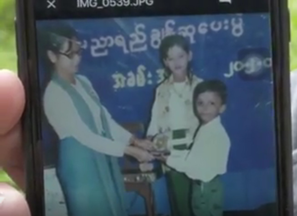 A young Salamat Khan Bin Jalil Khan receives a prize when he was in primary school in Myanmar.   Provided photo