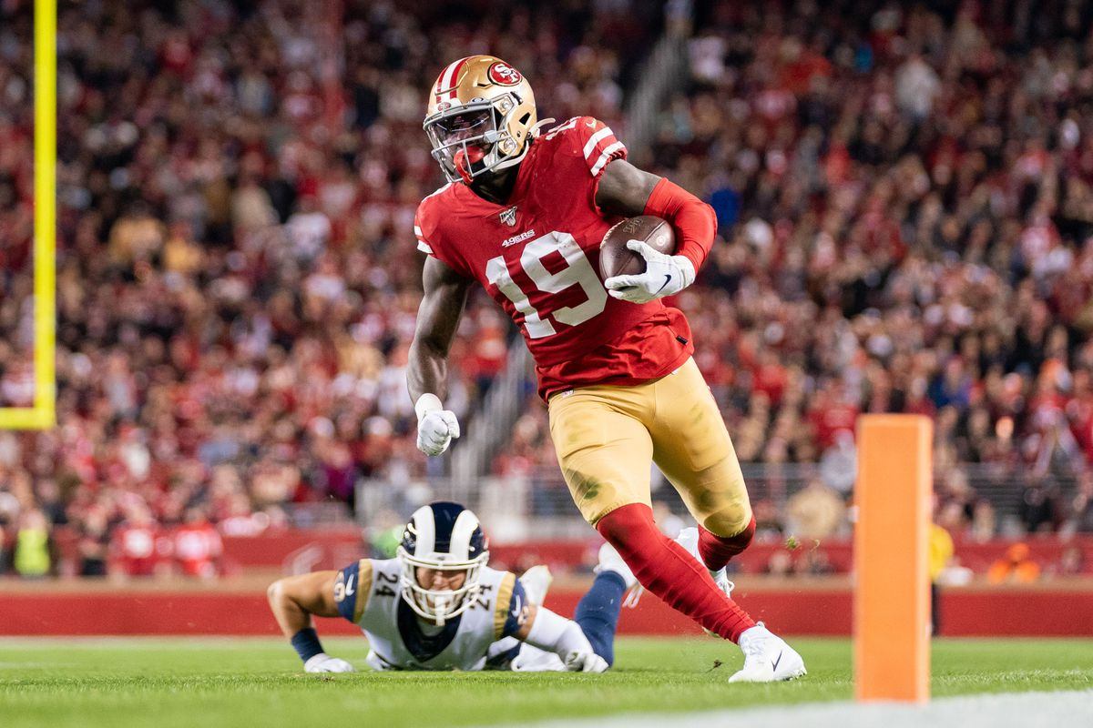 San Francisco 49ers wide receiver Deebo Samuel runs past Los Angeles Rams safety Taylor Rapp during the second quarter at Levi's Stadium.