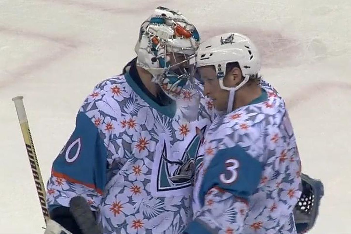 San Jose Barracuda goaltender Aaron Dell is congratulated by defenseman Karl Stollery following his 26-save shutout in the Barracuda's 3-0 win over the San Diego Gulls at SAP Center Saturday night. (AHL Live)