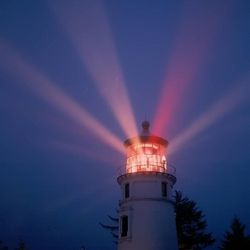 Light radiates from the Umpqua River Lighthouse in Winchester Bay, Ore.