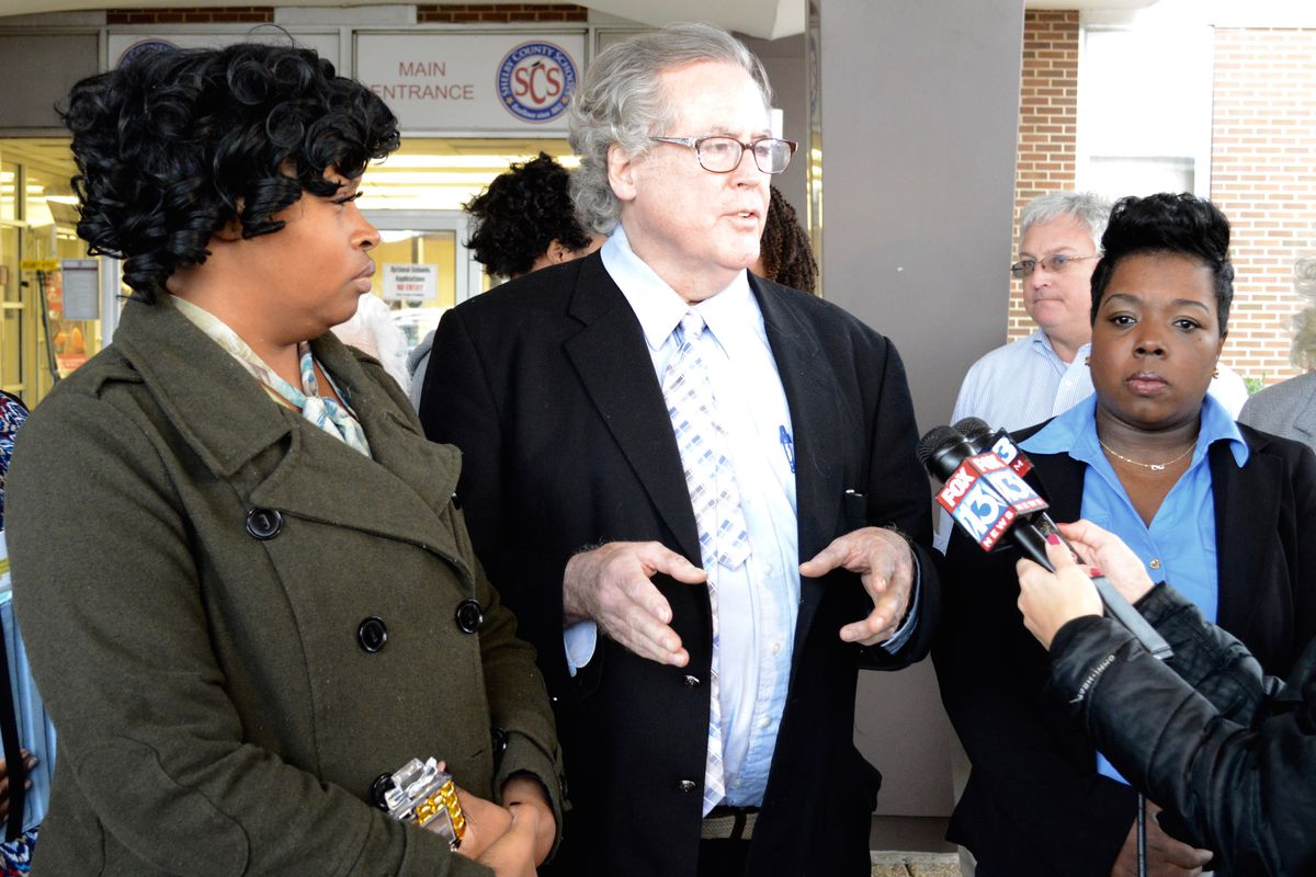 From left: Shelby County Schools Board of Education members Stephanie Love and Mike Kernell speak at an anti-voucher rally that was attended by supporters of the pro-voucher group Black Alliance for Educational Options.