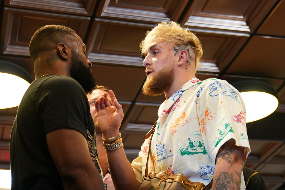 Professional MMA fighter Tyron Woodley and YouTube star Jake Paul face off in front of Bar Stool Sports founder Dave Portnoy at World Famous 5th St. Gym.