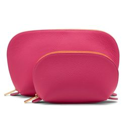 """<b>Cuyana Travel Cases</b><br> What's not to love about this <a href=""""http://www.cuyana.com/essentials/travel-cases.html"""">Cuyana travel set</a>? Two adorable, leather travel cases ($95) available in fabulous, bright colors (red, fuchsia, green, blue, ora"""