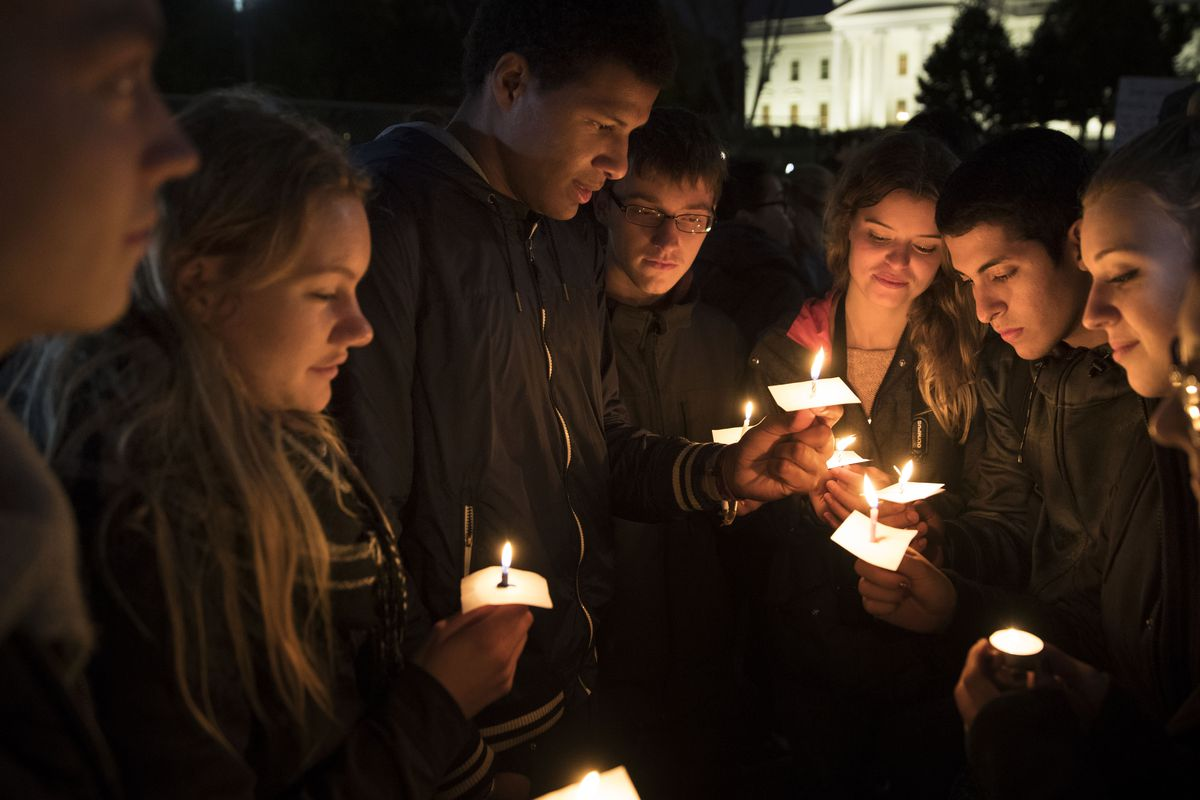 People gather for an anti-Donald Trump candlelight vigil in front of the White House November 9, 2016, in Washington, DC.