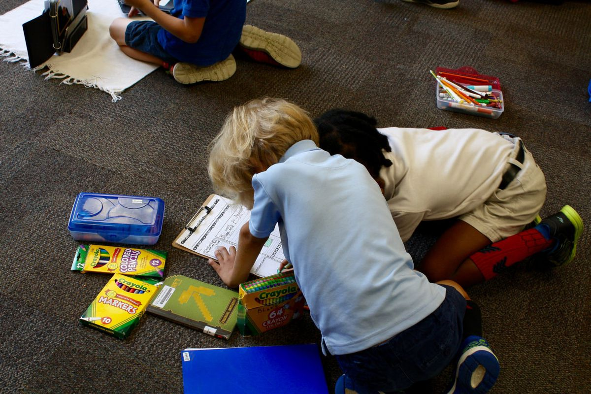 Together, two School 91 students work on reading and writing.
