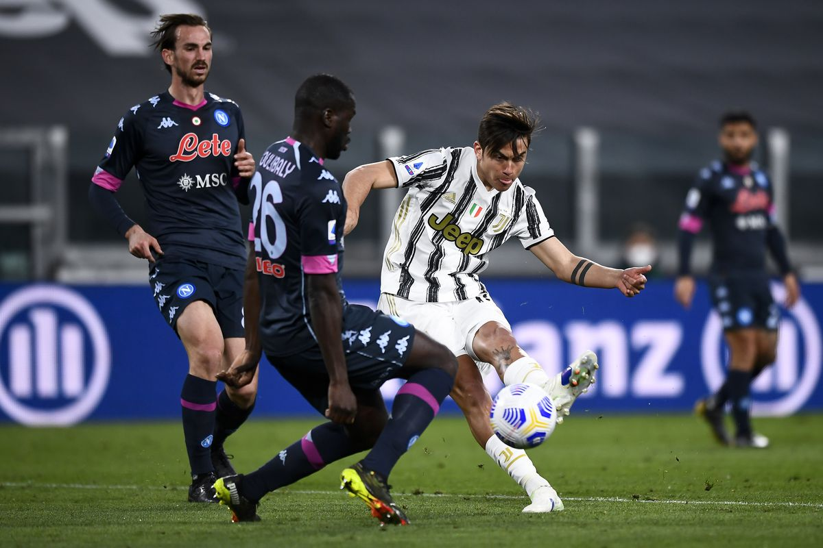 Paulo Dybala (C) of Juventus FC scores a goal during the...
