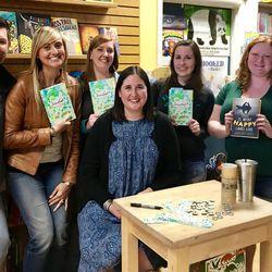 """YA and Wine"" book club members pose with author Jennifer E. Smith."