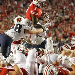 Wisconsin running back Bradrick Shaw (7) scores against Utah State's Chase Christiansen (48) during the first half of an NCAA college football game Friday, Sept. 1, 2017, in Madison, Wis.