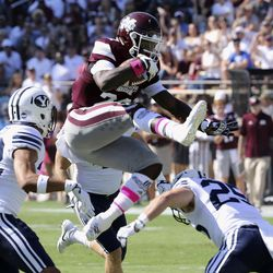Mississippi State running back Aeris Williams (22) hurdles over BYU defensive back Tanner Jacobson (25) during the first half of an NCAA college football game in Starkville, Miss., Saturday, Oct. 14, 2017.