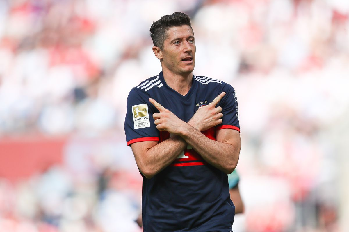 COLOGNE, GERMANY - MAY 05: Robert Lewandowski #9 of Bayern Munich celebrates after scoring a goal to make it 1-2 during the Bundesliga match between 1. FC Koeln and FC Bayern Muenchen at RheinEnergieStadion on May 5, 2018 in Cologne, Germany.