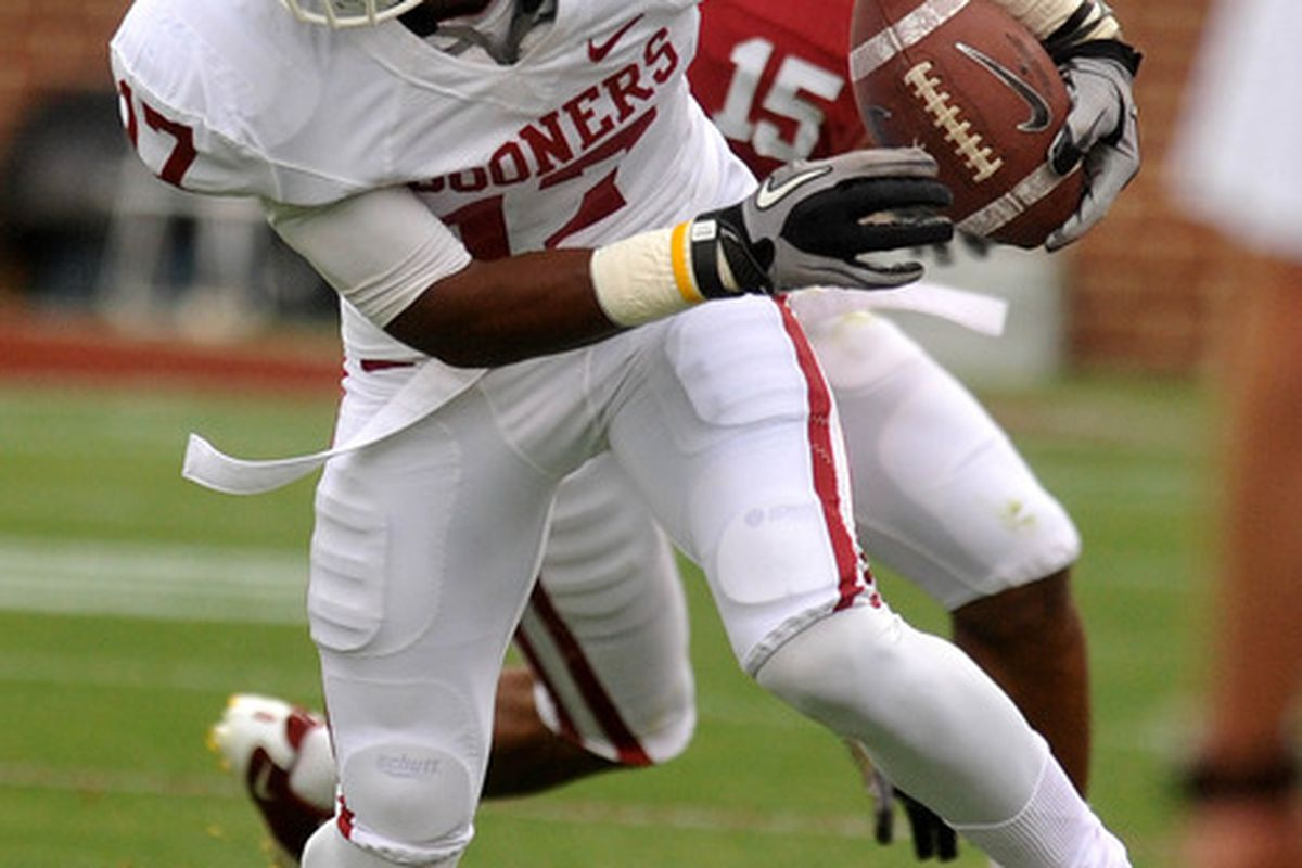 Apr 14, 2012; Norman, OK, USA; Oklahoma Sooners receiver Trey Metoyer (17) runs with the ball during first half of the Oklahoma spring game at Gaylord Family Oklahoma Memorial Stadium. Mandatory Credit: Mark D. Smith-US PRESSWIRE