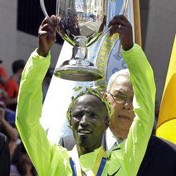 Wesley Korir of Kenya hold his trophy after winning the men's division of the 2012 Boston Marathon in Boston, Monday, April 16, 2012. (AP Photo/Elise Amendola)