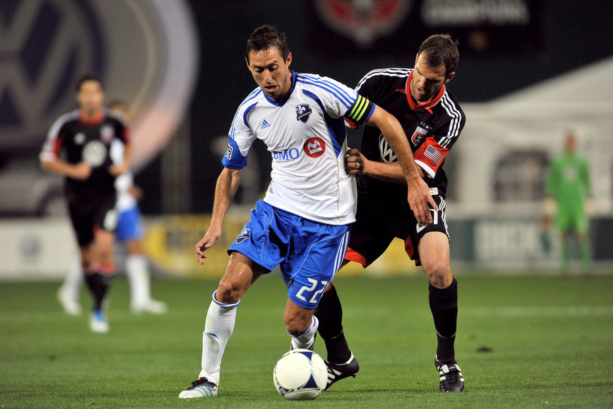 WASHINGTON, DC - APRIL 18:  Davy Arnaud #22 of Montreal Impact controls the ball against Daniel Woolard #21 of D.C. United at RFK Stadium on April 18, 2012 in Washington, DC. Montreal Impact tied D.C United 1-1. (Photo by Larry French/Getty Images)